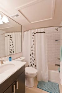Old City apartment with subway tile bath and large vanity mirror
