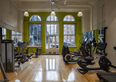 Fitness center at Chocolate Works Old City apartments